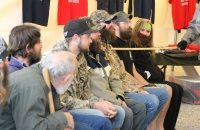 Men line up for the audience to judge whose beard is the most impressive in the Goose Dynasty Beard Contest on February 28.