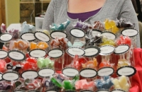 A local Utah women creates and sells her homemade suckers and chocolates at the Snow Goose Craft Fair.